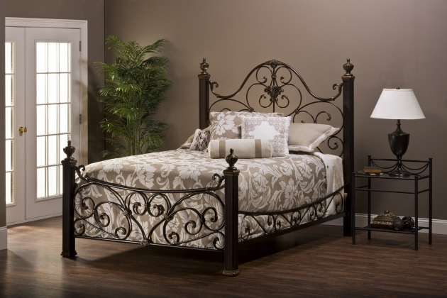 Wrought Iron Headboard Dark Brown With Carved Accent Footboard Using White Beige Floral Pattern Bed Quilt Image 00